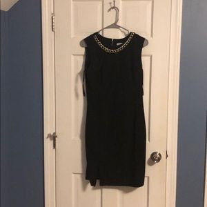 Calvin Klein black dress with gold necklace
